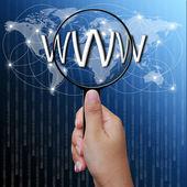 Www, ord i förstoringsglas, nätverk bakgrund — Stockfoto