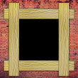Brick wall with wood frame — Stock Photo