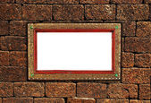 Old photo frame on the stone wall — Stock Photo
