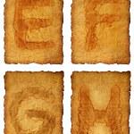 oud papier alfabet — Stockfoto