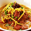 Khao Soi (Northern Thai Noodle Curry Soup) - Stock Photo