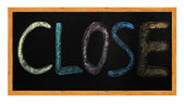 Closed word written with chalk on a blackboard — Stock Photo