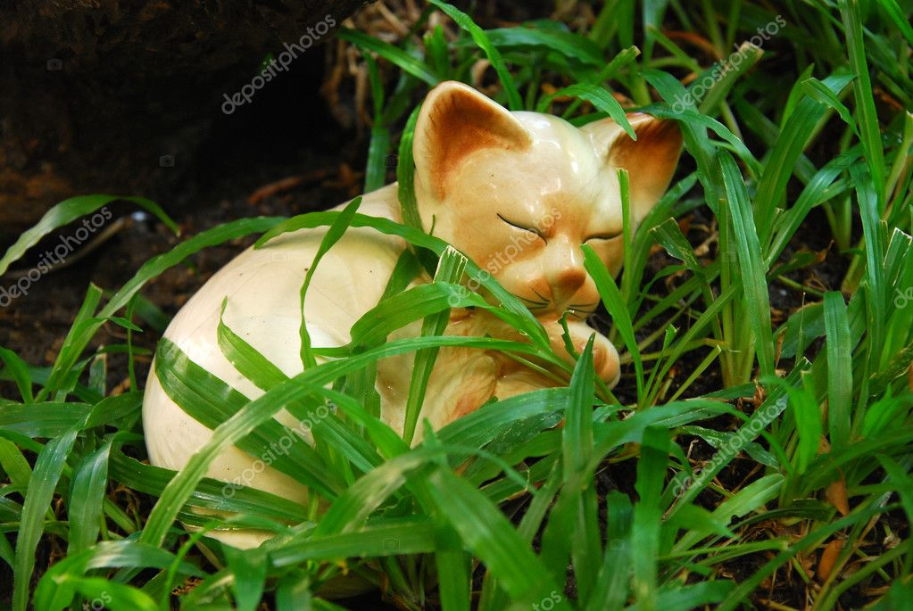 Ceramic cat in the grass  Stock Photo #9304963