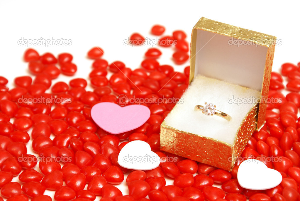 An engagement ring on some heart candy.  Stock fotografie #8109577