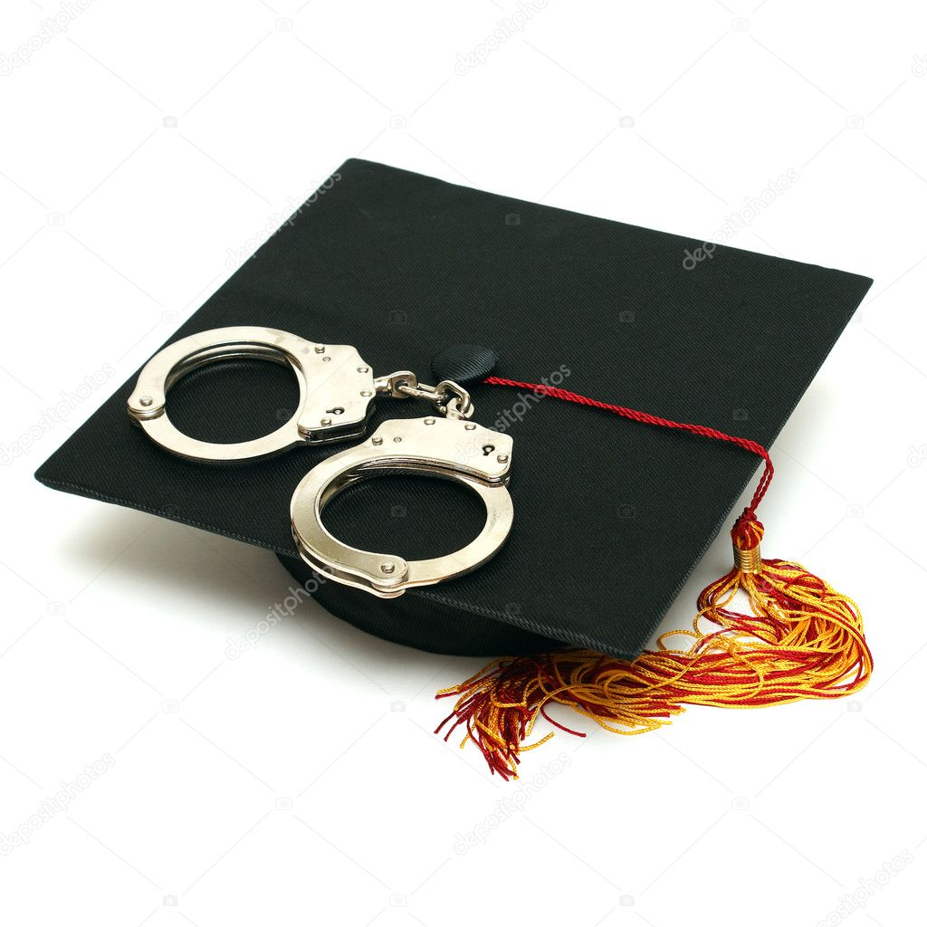 A mortarboard and pair of handcuffs are isolated for police graduates. — Stock Photo #8813228