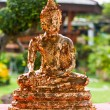 Stock Photo: Buddhwith gold leaf stuck