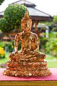 Buddha with gold leaf stuck — Stock Photo