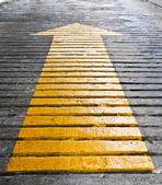 Yellow arrow — Stock Photo