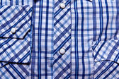 Blue and white shirt buttons — Stock Photo