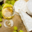 Stock Photo: White wine, Brie, Camembert and grape