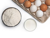 Eggs, glass of milk and flour — Stock Photo