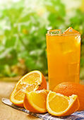Orange juice on the wood table — Stock Photo
