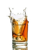 Whiskey splash in a glass — Stock Photo