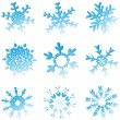 Set Of Blue Melting Snowflakes — Stock Vector #8240537