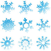 Set Of Blue Melting Snowflakes — Stockvector