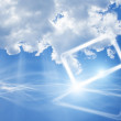 Abstract mobile device in sky with clouds — Stock Photo #9249911