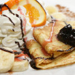 Pancakes with cheese, cream, banana, chocolate... — Stock Photo #8024268