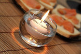 Candle on the table refectory — Stock Photo