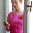 Woman and cell phone — Stock Photo