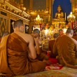 Buddhist monks praying (Thailand) - Stock Photo