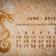 Stock Photo: 2012 year of Dragon calendar on old vintage paper