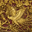 Stock Photo: Old phenix golden plate