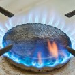 Blue flames from burner — Stock Photo