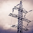 Stock Photo: High power electrical pole on cloudy day with silhouette