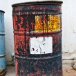 Old rusty oil drum - Stock Photo