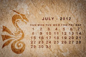 2012 year of the Dragon calendar on old vintage paper — Photo