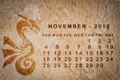 2012 year of the Dragon calendar on old vintage paper — Stock Photo