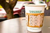 A cup of hot coffee in paper cup for the environment — 图库照片