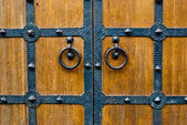 Wooden door with metal door handle — Stock Photo