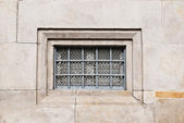 Old locked window on brick wall — Stock Photo