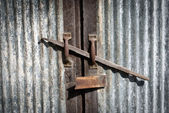 Old metal lock and metal door — Stock Photo