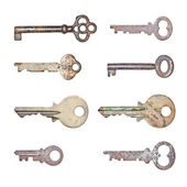 A collection of rusty old keys in isolated white background — Stock Photo