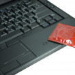 Condom on laptop — Stock Photo #8200214