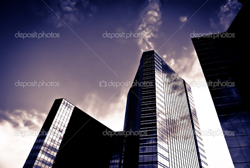 Large commercial building with with silhouette taken on a sunny day    #8200175