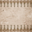 Rusty keys on old paper background - Stock Photo