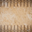 Rusty keys on old paper background — Stock Photo