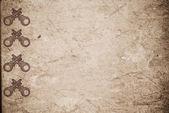 Llaves oxidadas sobre papel viejo — Foto de Stock