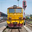 Stock Photo: Old diesel train moving away from train station
