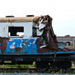 A wreckage of crashed or damaged train taken from train yard - Stock Photo