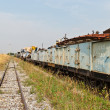 Railway looking forward with train wreckage on the right - Stock Photo