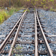 Rail way going toward a dead end - Stock Photo