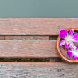 Thai orchid on wood platform - Stock Photo