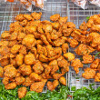 Thai deep fried fish cake on sale on the street - Stock Photo