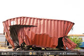 A wrackage of steel container taken from train yard — Stock Photo