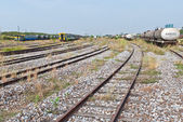 Large railway yard landscape with train on the right — Stock Photo