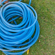 Blue garden water hose stack together — Stock Photo